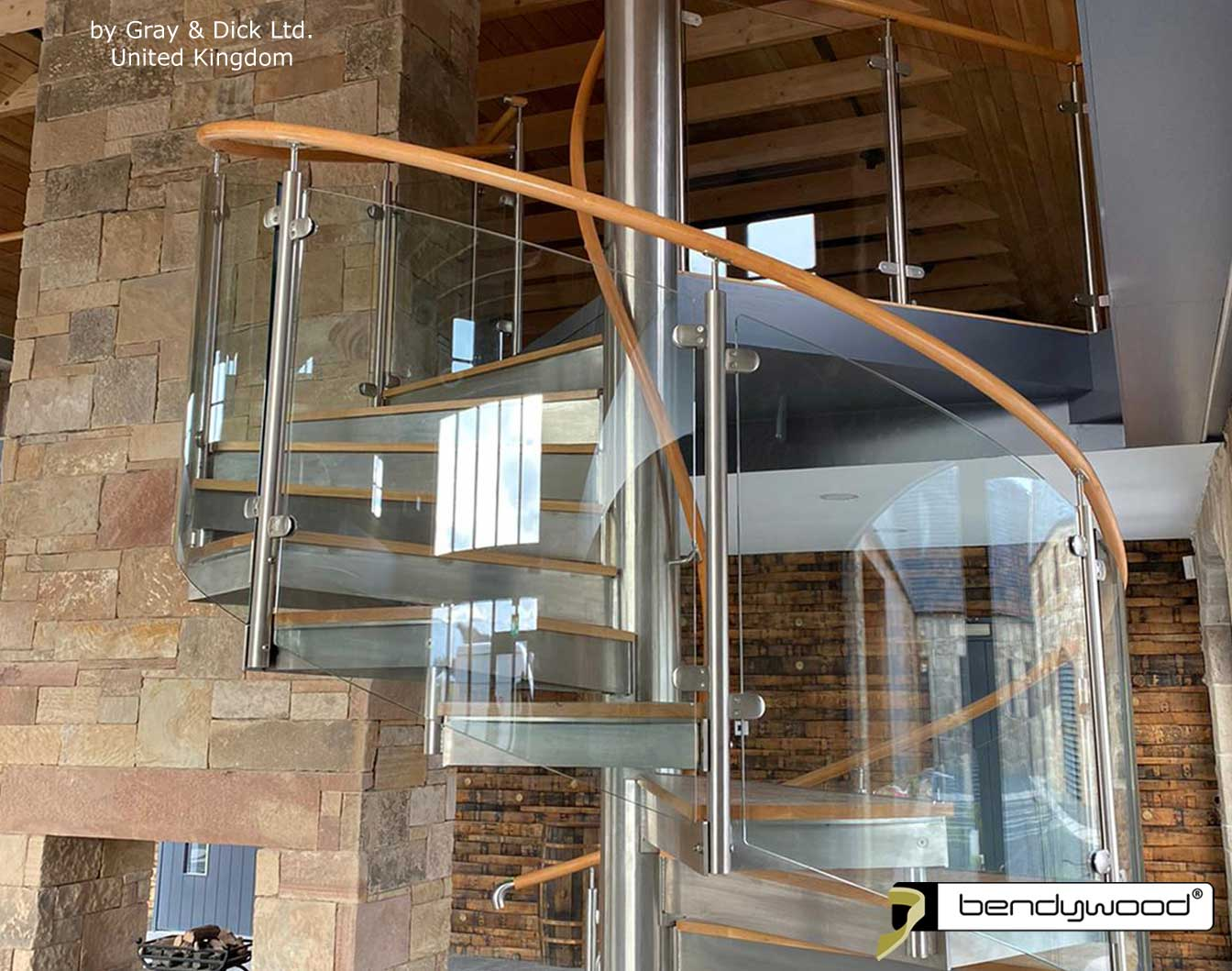 Bending wood Bendywood® - curved solid wooden handrail on glass railing